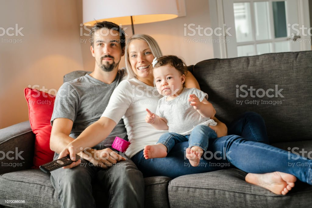 A family mother, father, child daughter at home