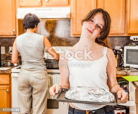 istock Family, mother with daughter, cook together 472200189