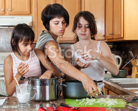 971346934 istock photo Family, mother with two daughters, cook meatballs 483119067
