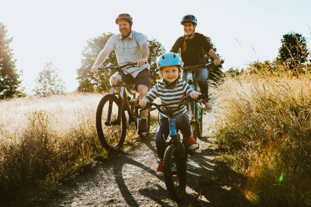 Family Mountain Bike Riding Together on Sunny Day
