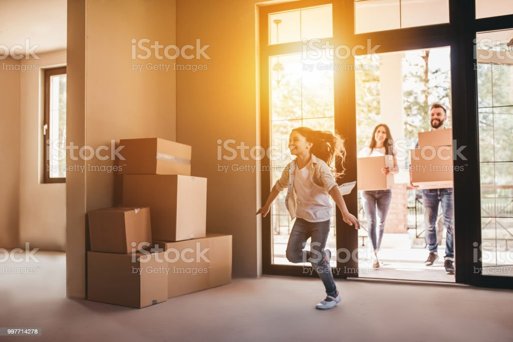 Family moving in new house stock photo