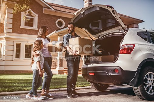 istock Family moving in new house 997714500