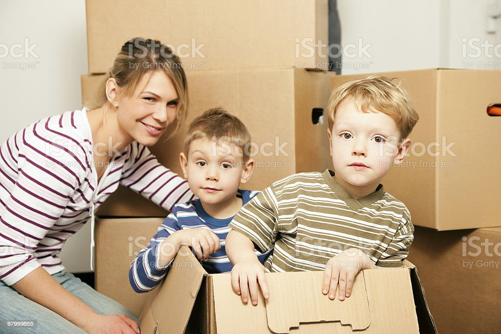 Family moving in their new house royalty free stockfoto