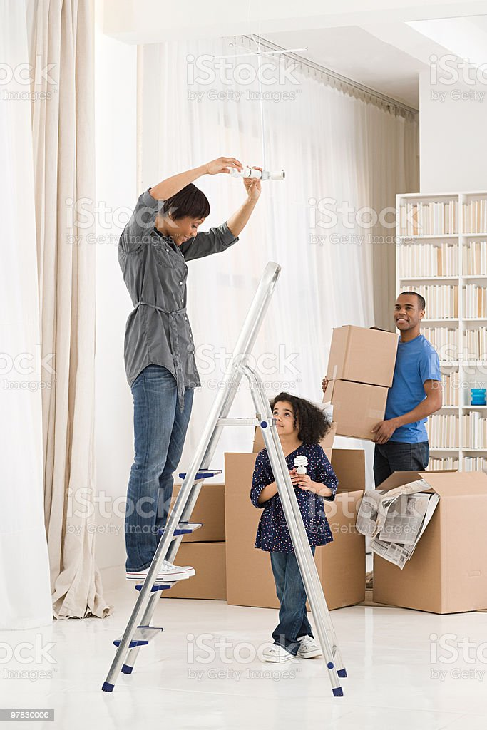 Family moving in to house stock photo