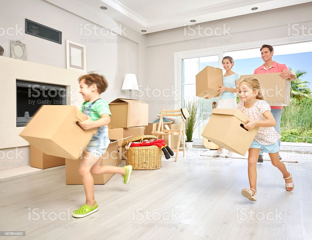 Family moving in to new house stock photo