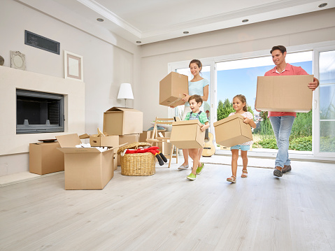 istock Family moving into a new home 488615790