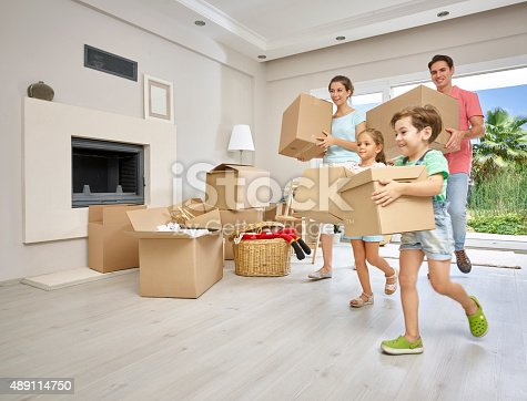 istock Family moving into a new home 489114750