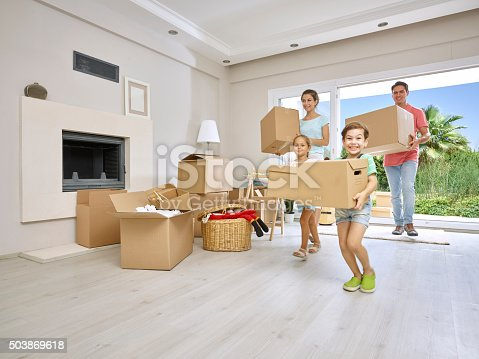 istock Family moving into a new home 503869618