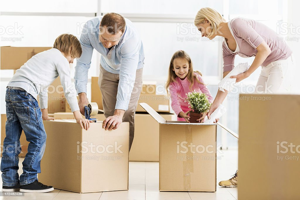 Family moving into a new house. royalty-free stock photo