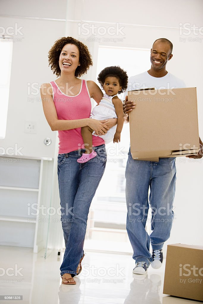 Family moving into new home stock photo
