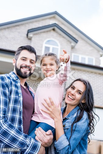istock family moving into new house 881508444