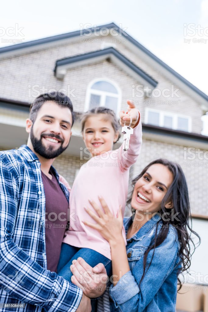 family moving into new house stock photo