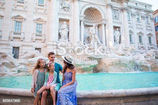 Happy family of four near Fontana di Trevi