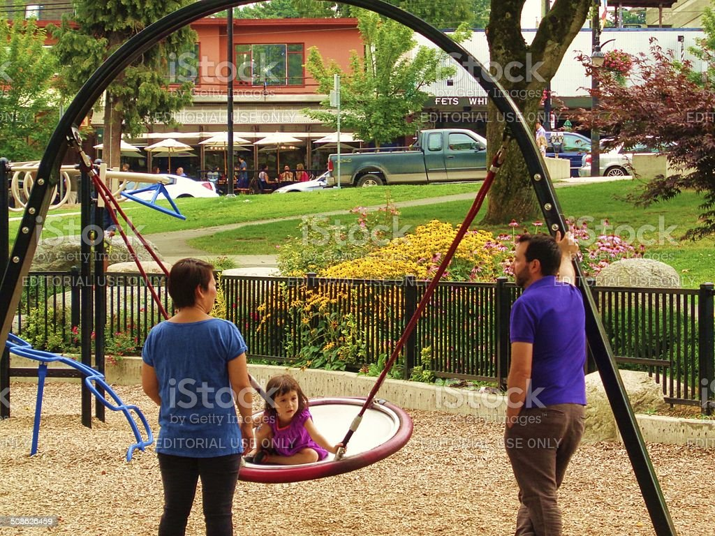 Family of 3 at park stock photo