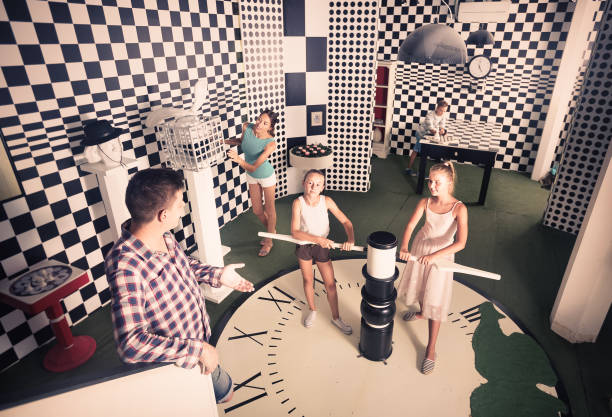 Family of five is having fun together in lost chessroom. stock photo