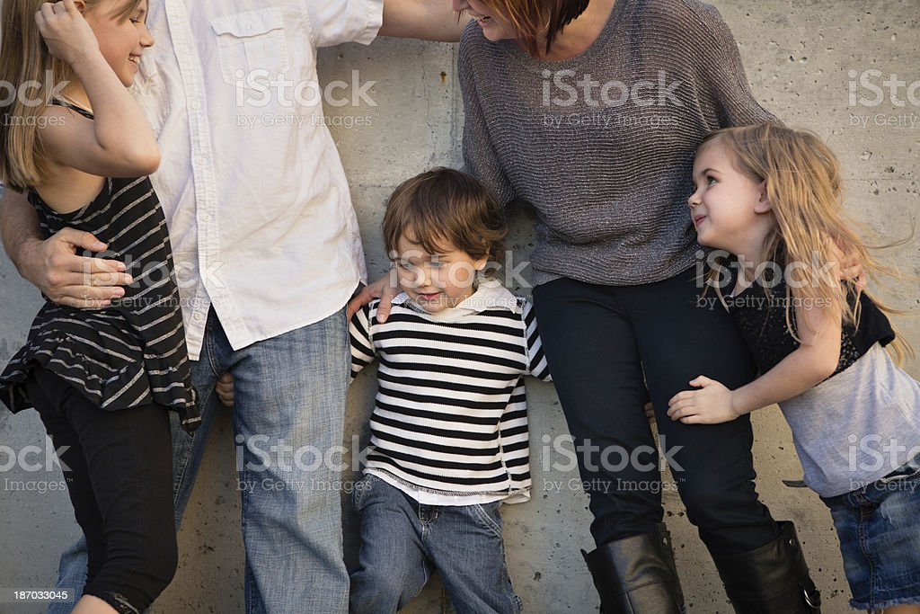 Family of Five Standing Outside By Cement Wall royalty-free stock photo