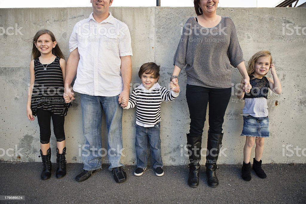 Family of Five Standing Outside By Concrete Wall royalty-free stock photo