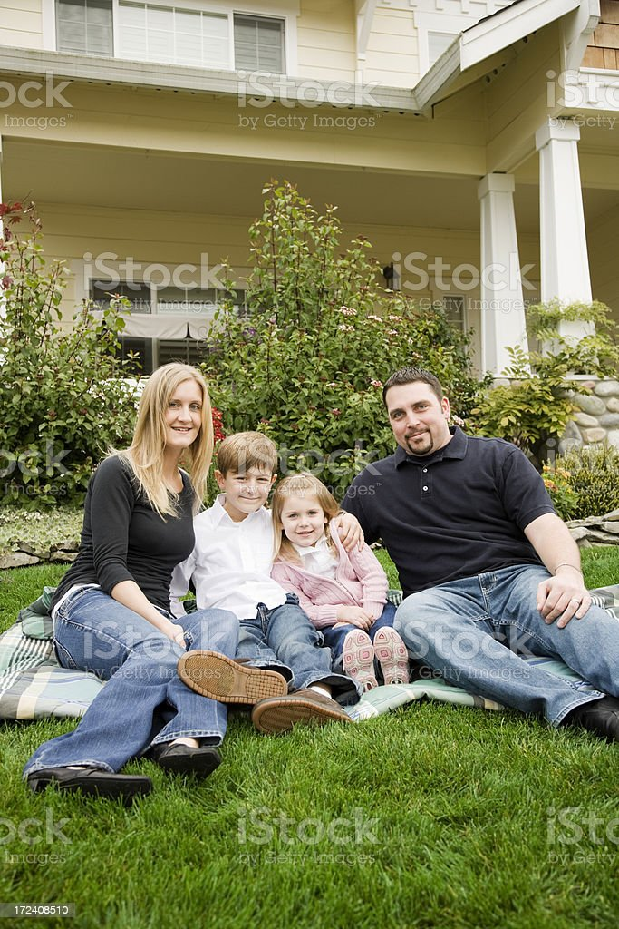 Family of Four at Home in Front Yard royalty-free stock photo
