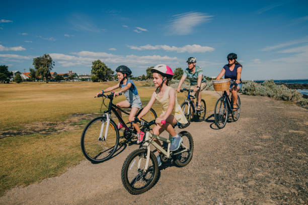 Family of Four Cycling in the Park stock photo
