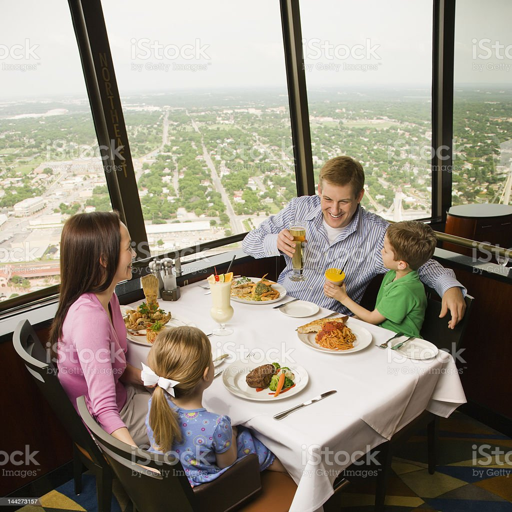 Family of four dining with view of San Antonio royalty-free stock photo