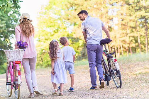 658444674 istock photo Family of four having fun with bikes in nature 812055228