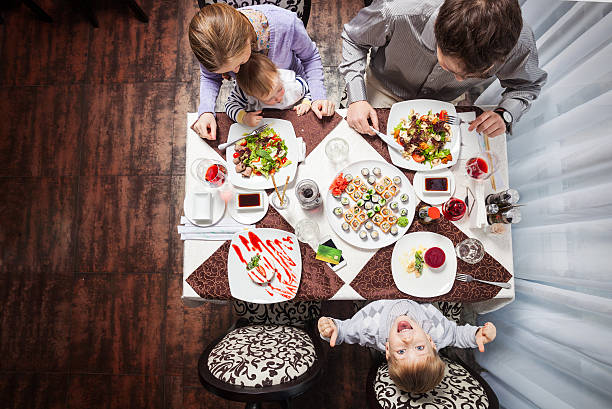 Family of four having meal at a restaurant stock photo