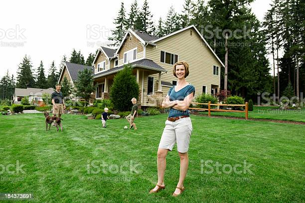 Family of four home with happy proud mom picture id184373691?b=1&k=6&m=184373691&s=612x612&h=r6dgu ne7ojuznhl yphrcj4rvqsgzyuvdxebsvolag=