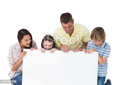 istock Family of four looking at billboard 474403198