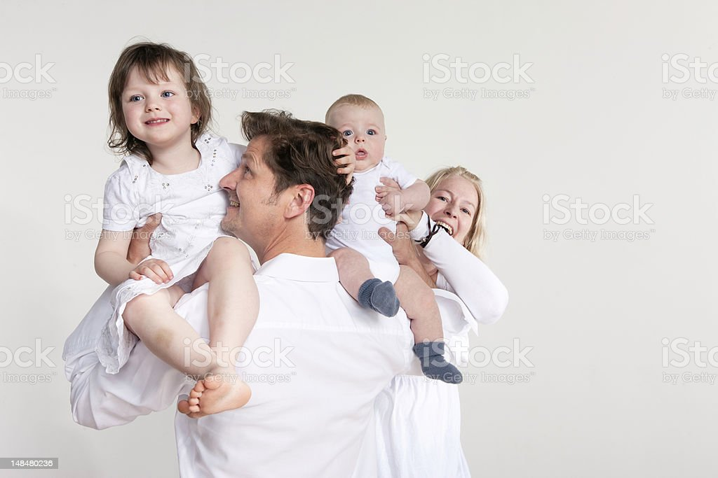 family of four | mom, dad, little girl, boy stock photo