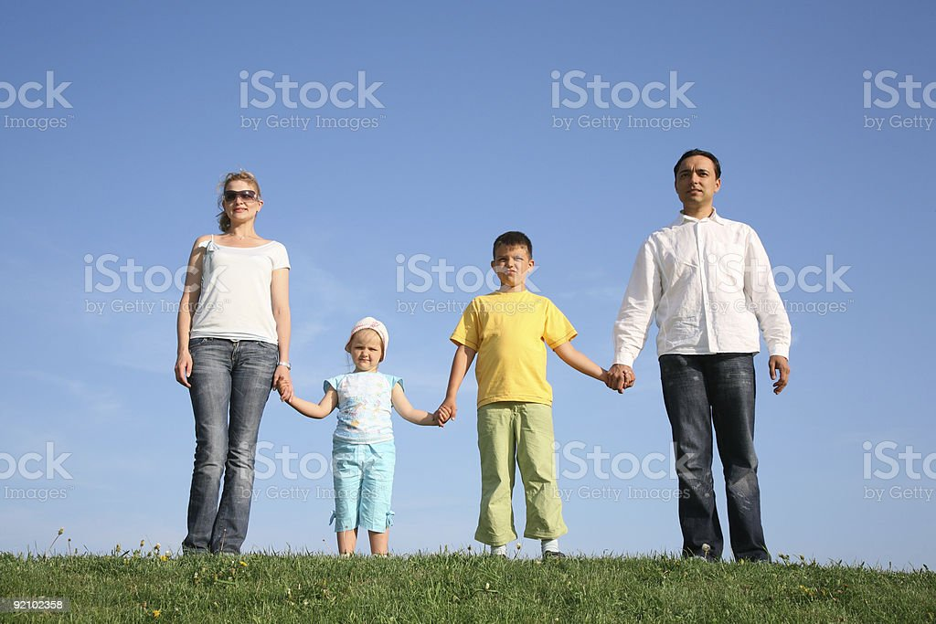 family of four on grass royalty-free stock photo