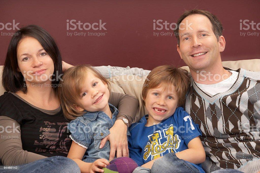 Family of four on sofa royalty-free stock photo