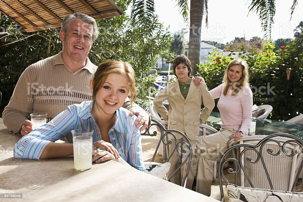 Family of four on vacation royalty-free stock photo