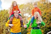 istock Family of four outdoors in autumn park 467182787