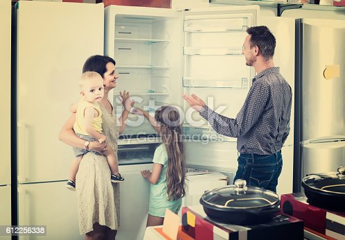 876810414istockphoto family of four shopping new refrigerator in home appliance store 612256338