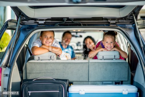 istock Family of four smiling ready for road trip 466729013