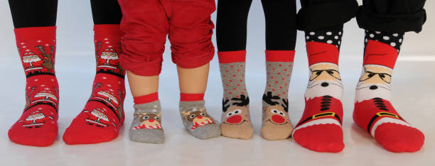 Family of four wearing Christmas socks – zdjęcie