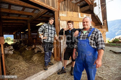 Family of Goat Farmers in Front of Stable.
