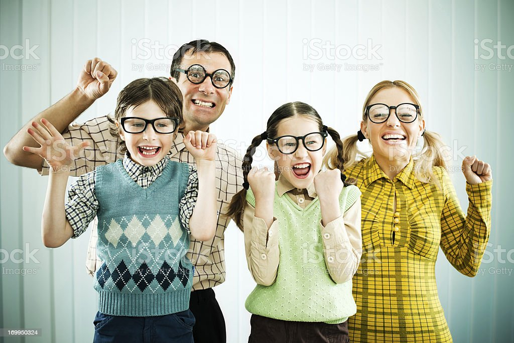Family of nerds smiling at the camera. royalty-free stock photo