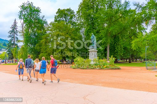 istock Family of students walking past statue of Claude Louis Berthollet 1283882009