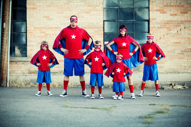 Family of Superheroes Watch out. This family of superheroes is going places. costume stock pictures, royalty-free photos & images