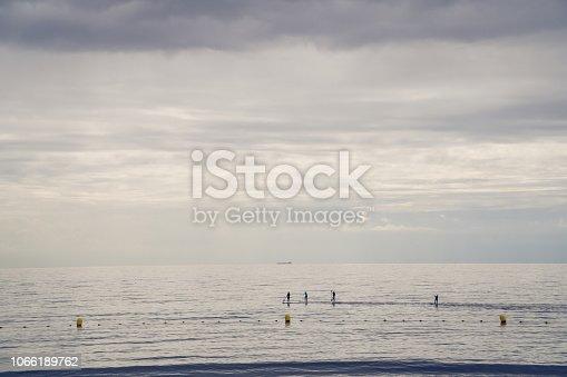 583830686istockphoto Family of Surfers in Atlantic ocean, Tenerife coast 1066189762