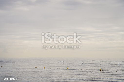 istock Family of Surfers in Atlantic ocean, Tenerife coast 1066189834