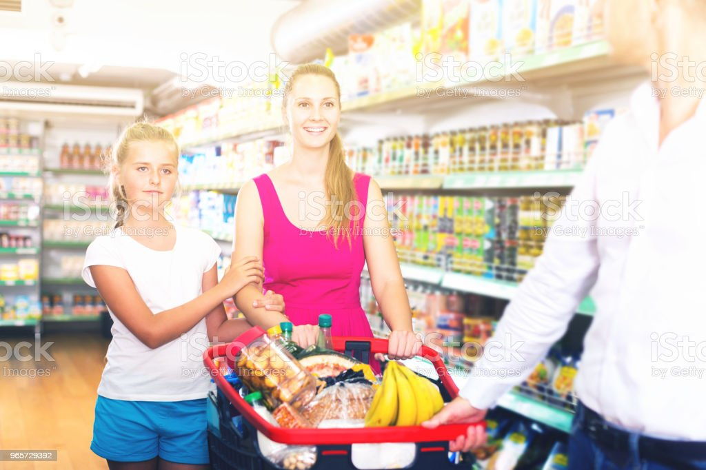 family of three choosing food in the grocery shop - Royalty-free 1910-1919 Stock Photo