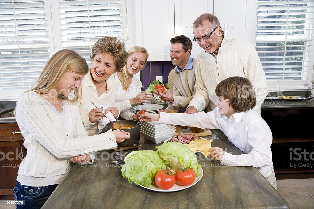 Family of three generations cooking lunch in the kitchen royalty-free stock photo