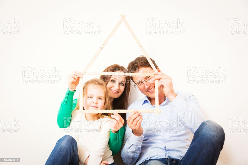 family of three with house shape stock photo