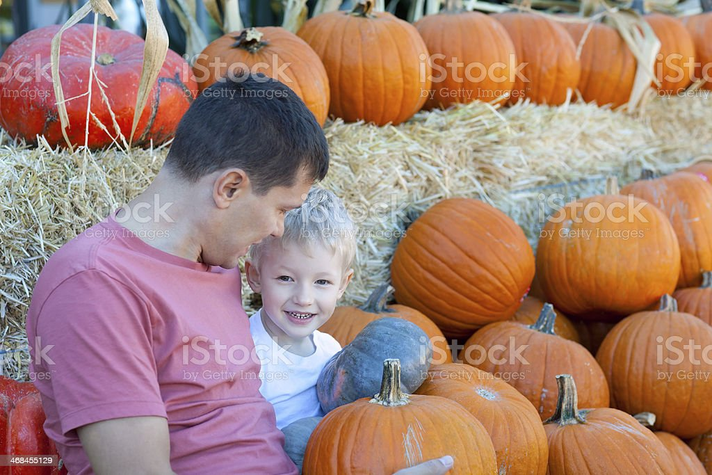 family of two at pumpkin patch royalty-free stock photo