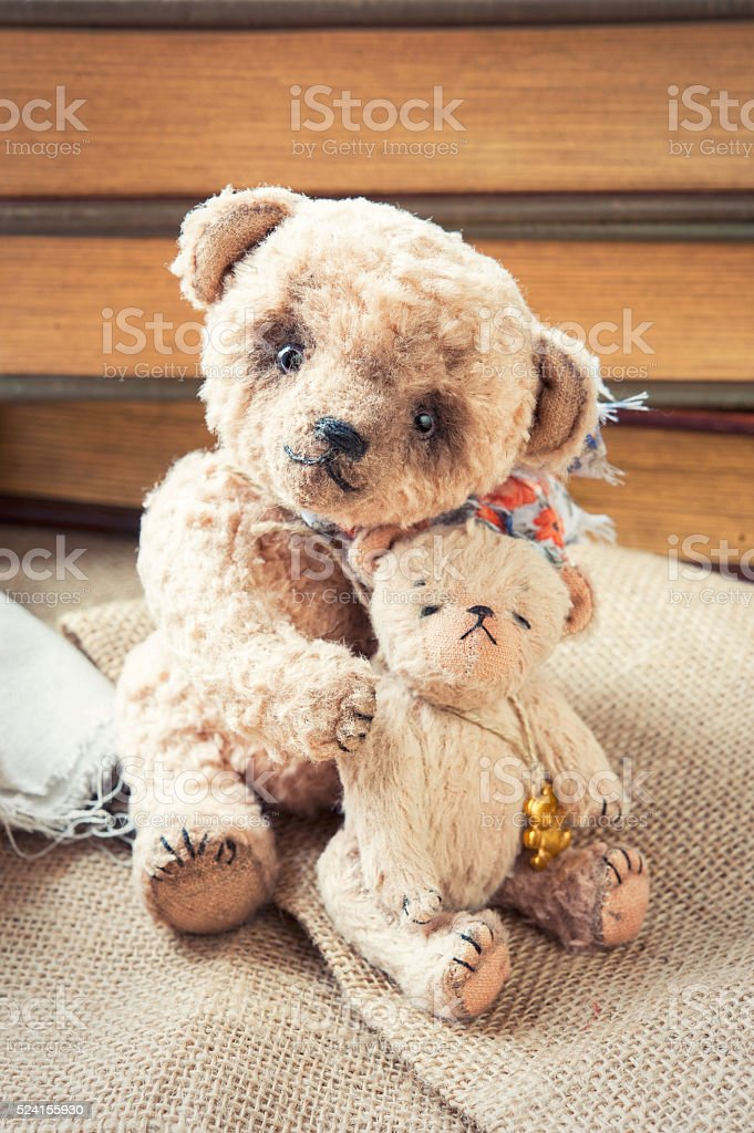 Family of two vintage handmade sweet embracing teddy bear toys stock photo