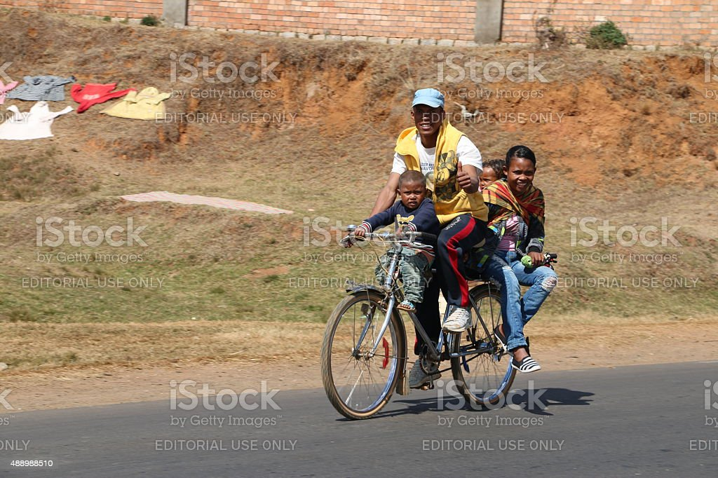 Family on a bicycle stock photo
