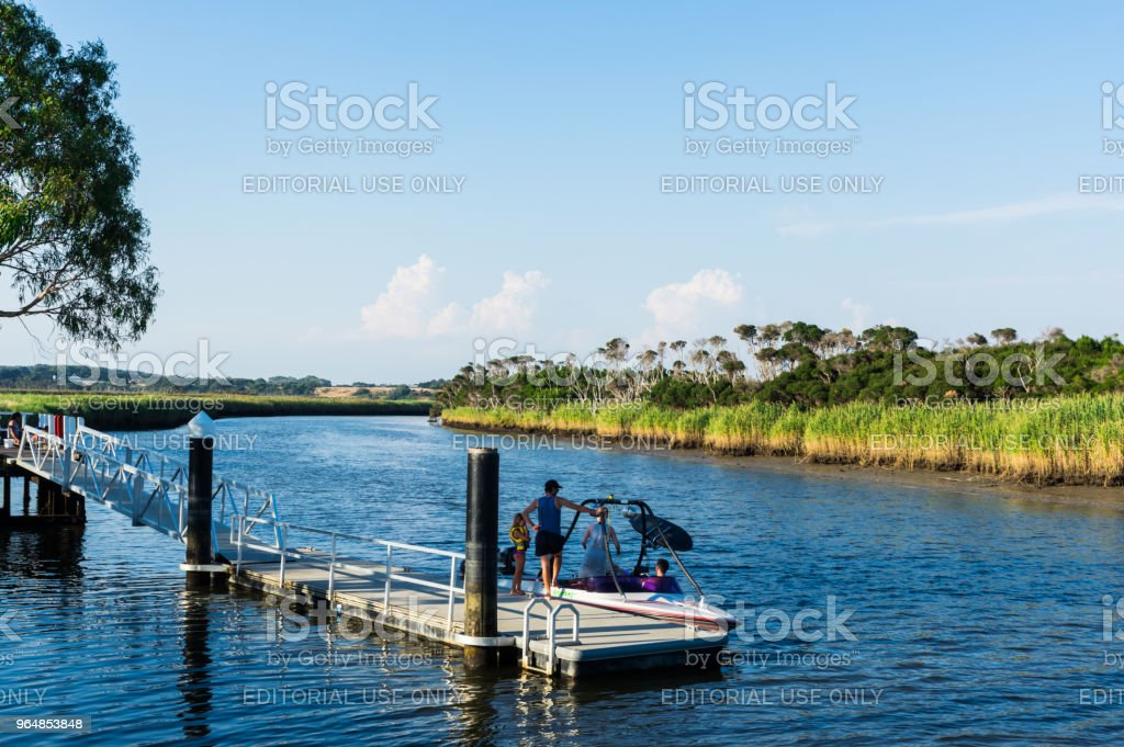A family on a jetty on the Tarwin River in South Gippsland. royalty-free stock photo