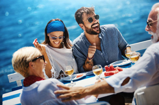 Family on a sailing cruise. stock photo